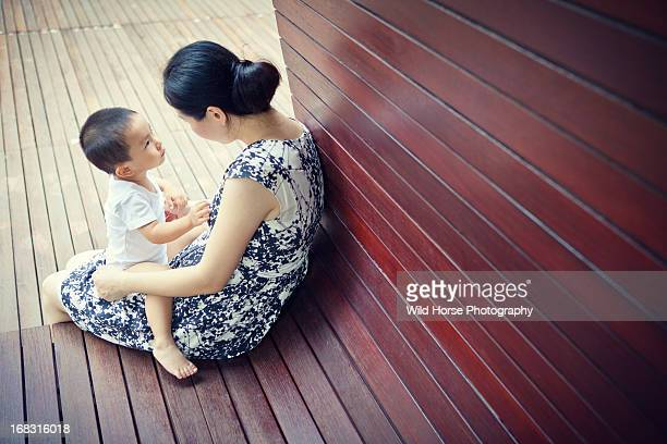 Little boy listening story with mother
