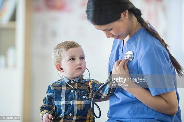 Little Boy Listening to the Nurse's Heartbeat