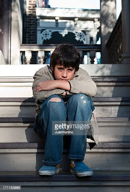 little boy living in poverty - poverty in america stock pictures, royalty-free photos & images