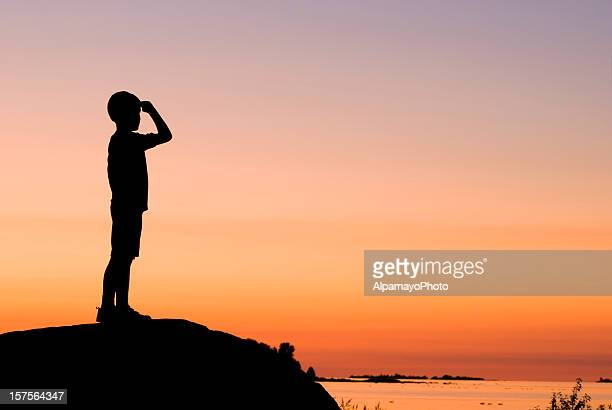Little Boy Looking Ahead in the Summer Evening