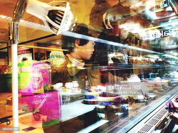 Little Boy Looking At Cakes At Bakery Store
