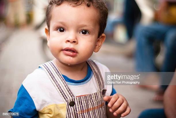 Little boy looking at camera