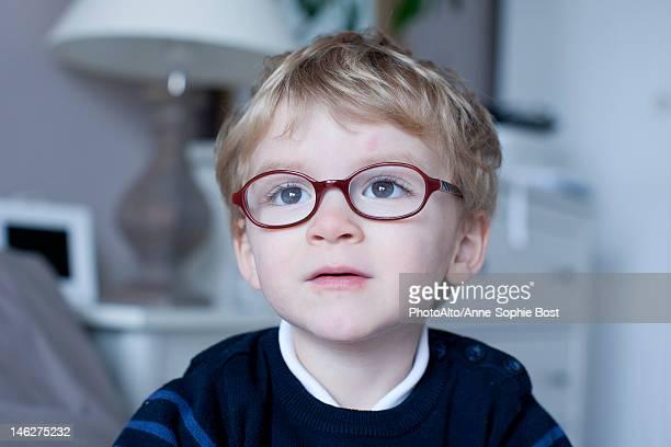 Little boy looking away in thought, portrait