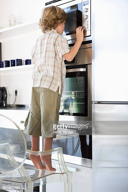 Little Boy Looking into the Microwave