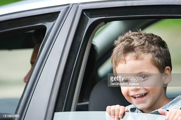 Little boy looking out car window, portrait