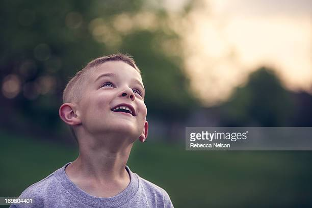 little boy looking to the skies - innocence stock pictures, royalty-free photos & images