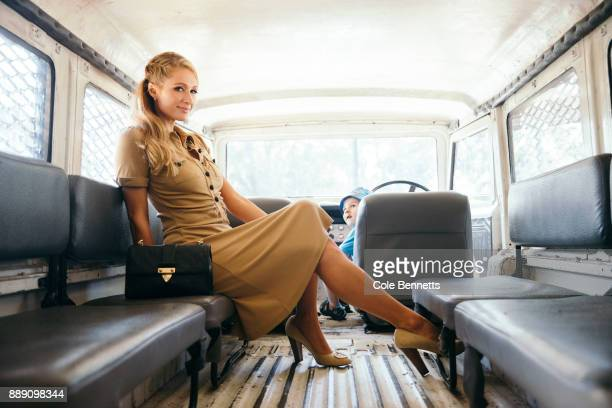 A little boy looks on in awe at Paris Hilton after sneaking into the drivers seat during a photoshoot and promotion visit to Australia to launch her...