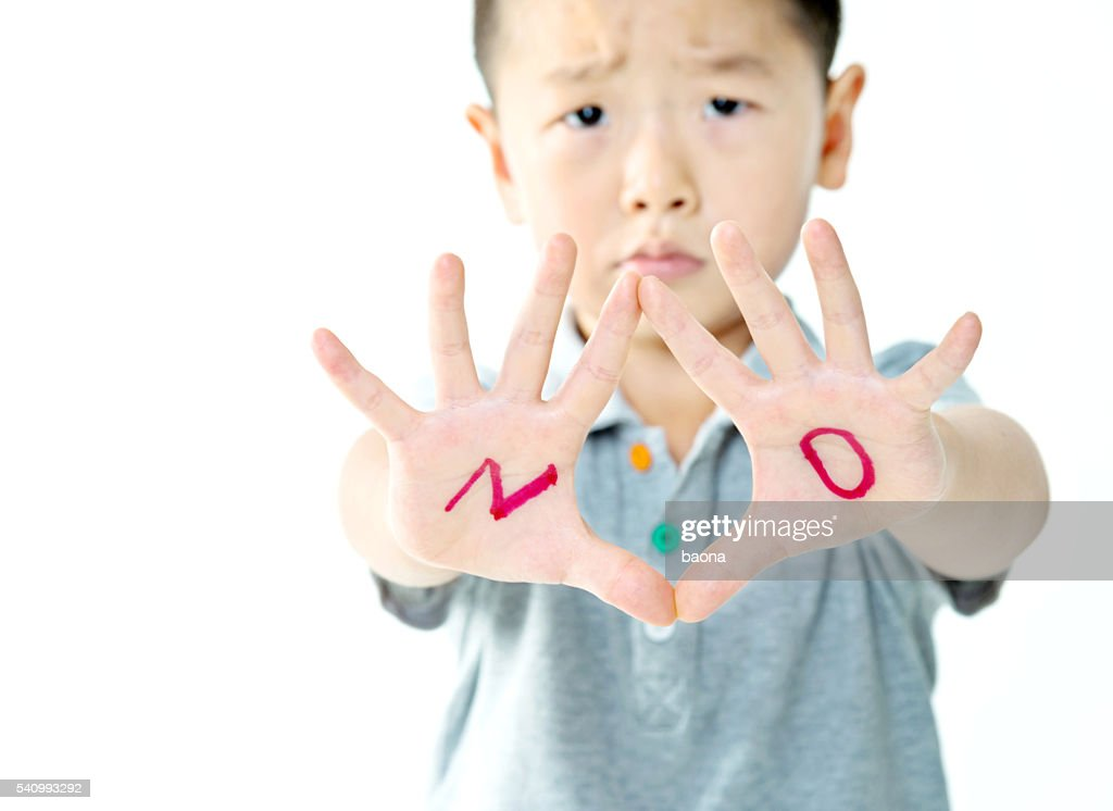 Little boy makes a stop gesture : Stock Photo