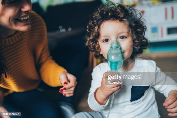 Little boy makes inhalation at home