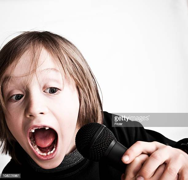 Little Boy Missing Two Front Teeth and Singing Into Microphone