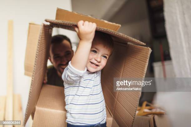 little boy moving into his new home - unpacking stock pictures, royalty-free photos & images