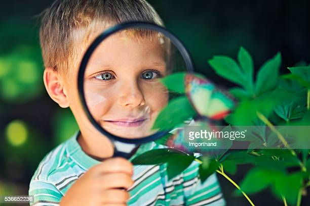 Little boy observing the mysteries of nature.