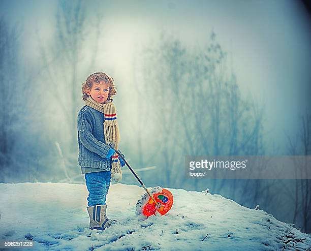 little boy on bicycle in the snow - loops7 stock photos and pictures
