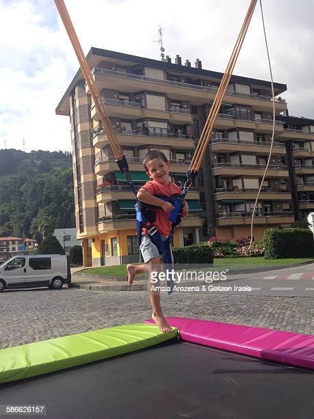 Little boy on bungee trampoline