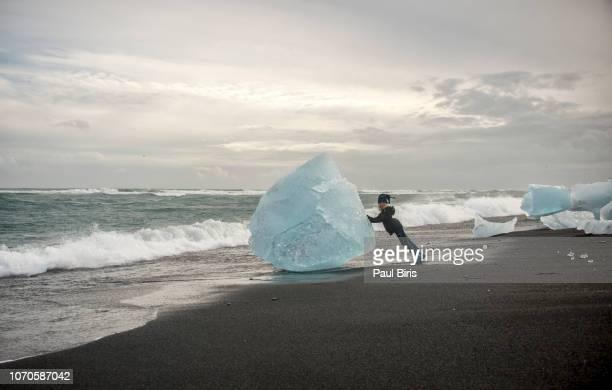 Little boy  on Diamond beach in Iceland