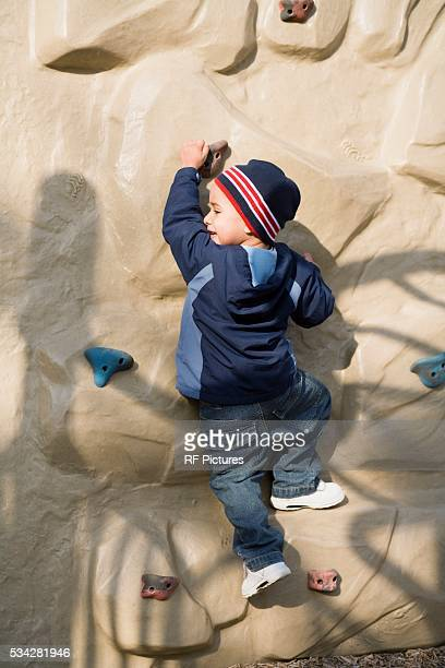 Little Boy on Rock Climbing Wall
