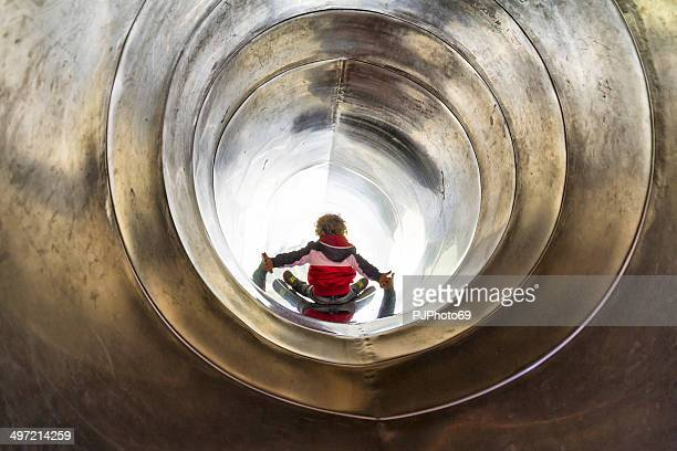 little boy on tunnel slide - pjphoto69 stock pictures, royalty-free photos & images