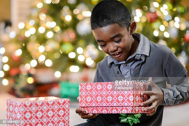 Little Boy Opening a Present