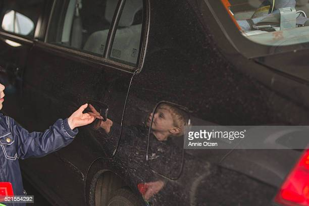 little boy opening up car door - fully unbuttoned stock pictures, royalty-free photos & images