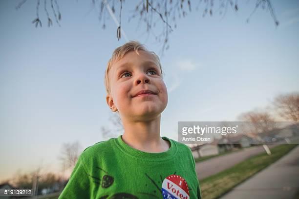 little boy outside - i voted sticker fotografías e imágenes de stock