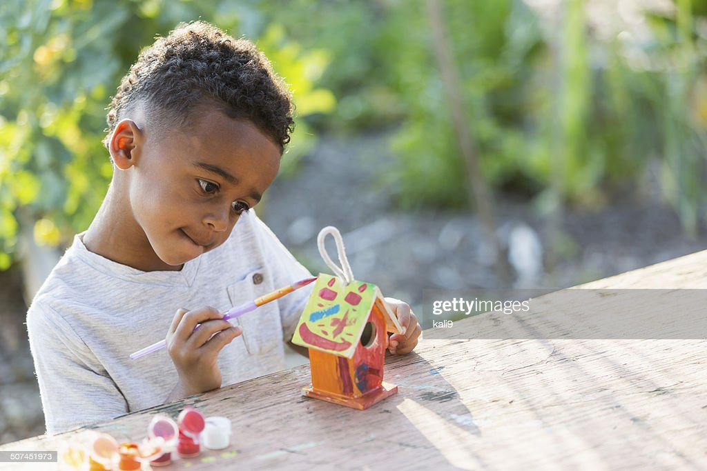 Remarkable Little Boy Painting Bird House High Res Stock Photo Getty Download Free Architecture Designs Scobabritishbridgeorg
