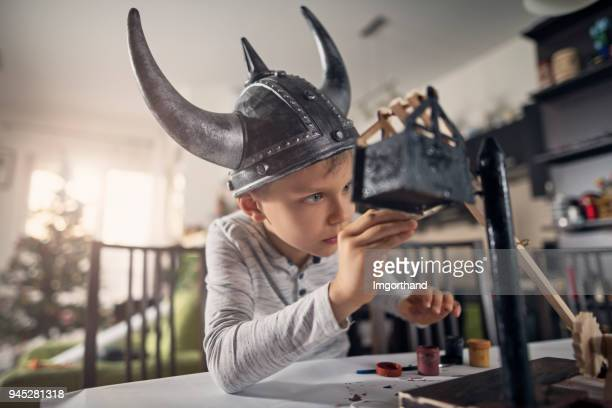 little boy painting model for school - imgorthand stock photos and pictures