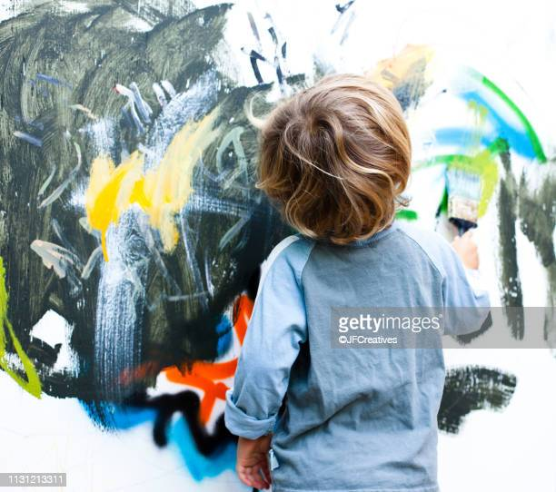 little boy painting - art stock pictures, royalty-free photos & images