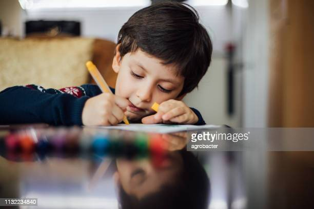 little boy painting - colouring stock pictures, royalty-free photos & images