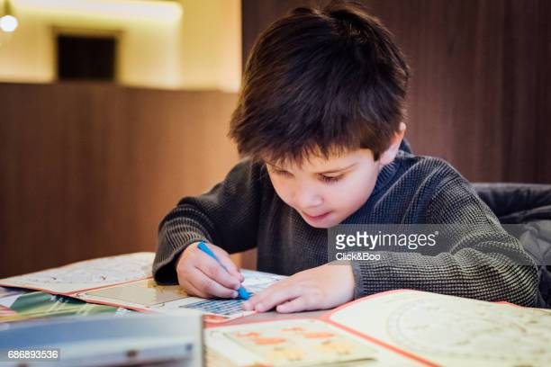 little boy painting with watercolors. - colouring stock photos and pictures