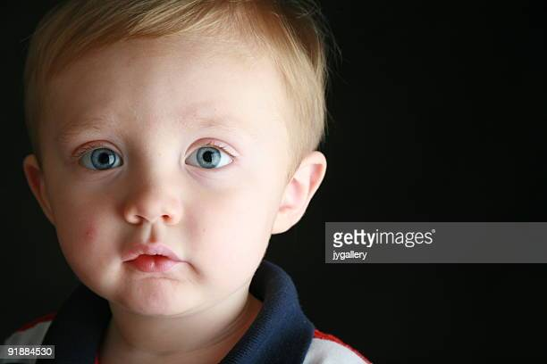 little boy - big eyes stock photos and pictures