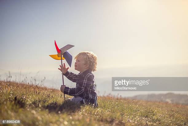 Little boy playing at the meadow