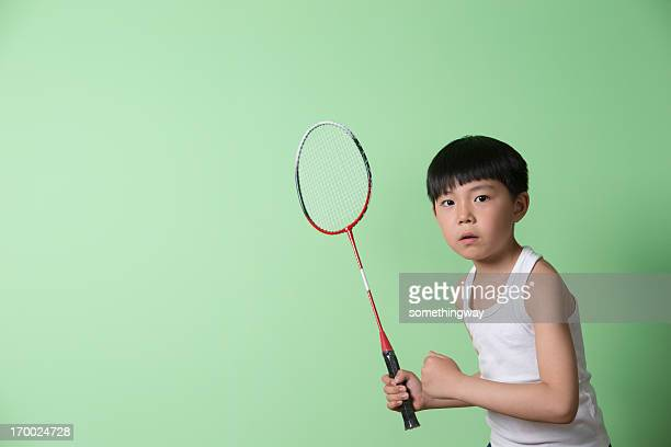 little boy playing badminton - shuttlecock stock pictures, royalty-free photos & images