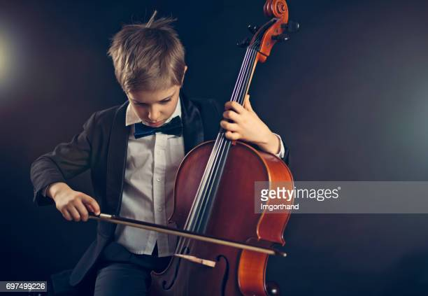 little boy playing cello - cello stock pictures, royalty-free photos & images