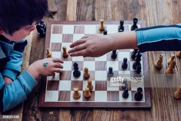little boy playing chess - image technique stock pictures, royalty-free photos & images