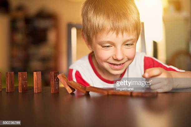 Little boy playing domino