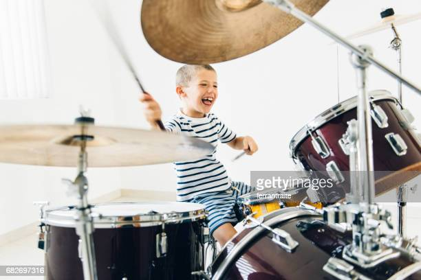 little boy playing drums - three quarter length stock pictures, royalty-free photos & images