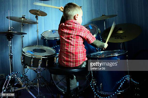 Little boy playing drums