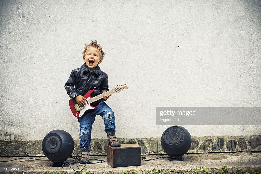 Little boy playing electric guitar : Stock Photo