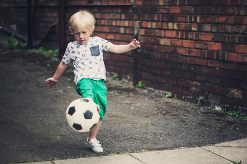 Little boy playing football - gettyimageskorea