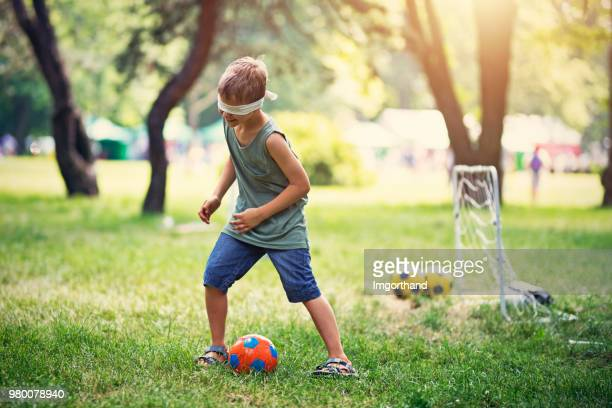 Little boy playing funny games in the park