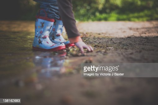 Little Girls Play In The Mud Stock Photo - Download Image