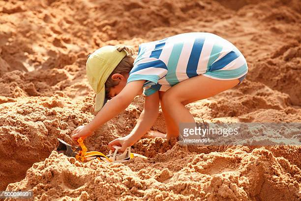 Little boy playing in sand box