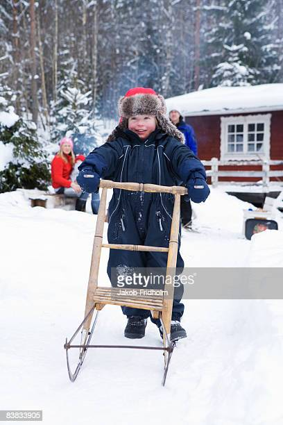 A little boy playing in the snow Sweden.