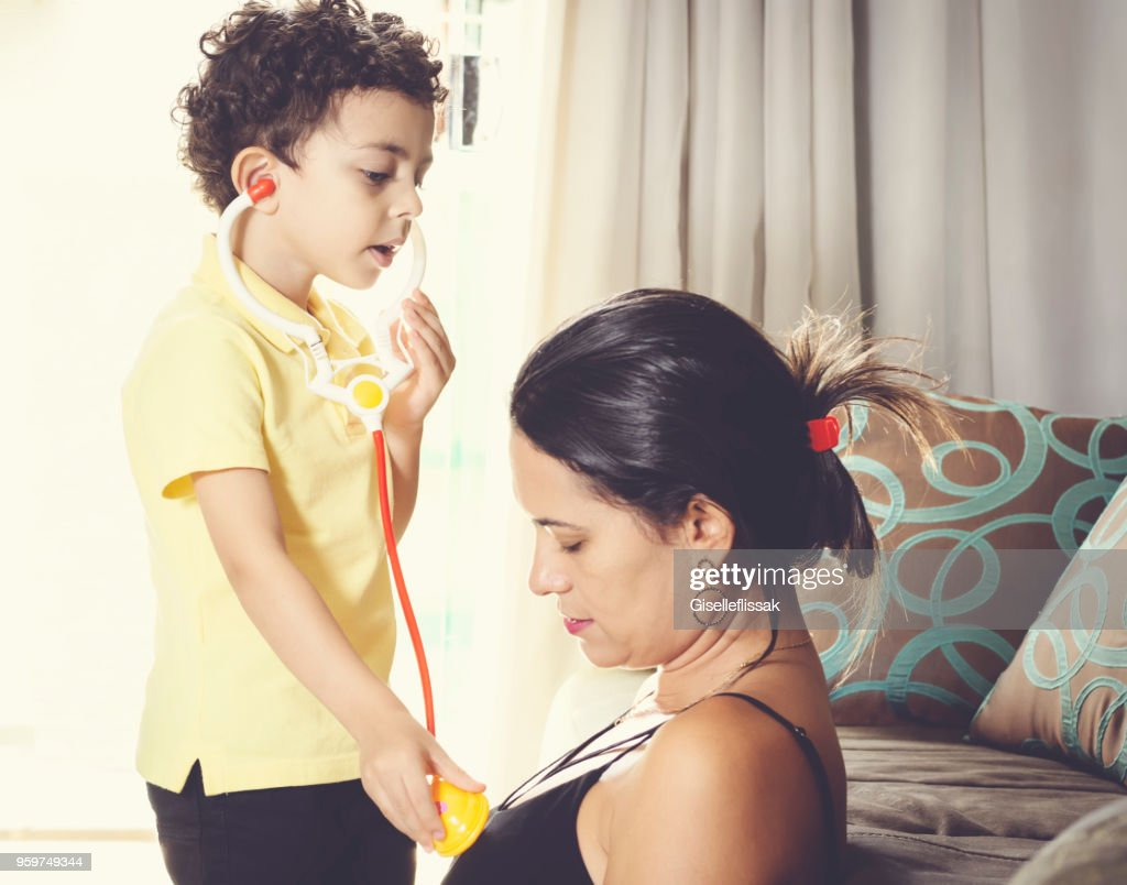 Little boy playing like a doctor with his mother. : Stock Photo