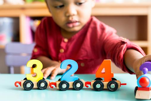 Little boy playing mathematics wooden toy at nursery 1095815742
