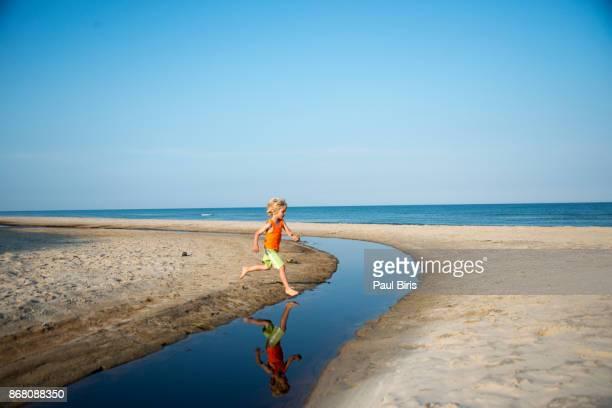 Little boy  playing on beach , near Skagen, Denmark