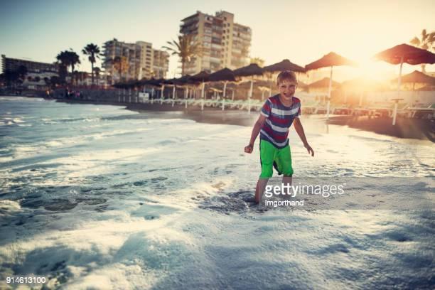 Little boy playing on beach
