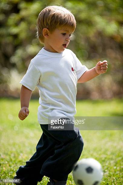little boy playing soccer - fabio filzi stock photos and pictures