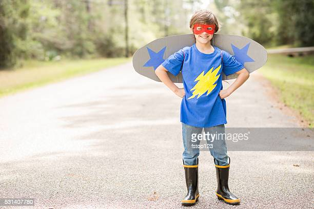 little boy playing superhero outdoors. pretend, dress up. - home made stock pictures, royalty-free photos & images