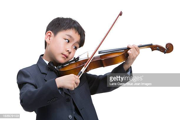 Little boy playing the violin
